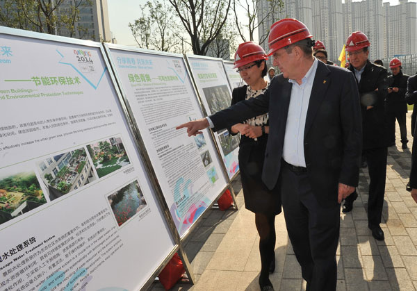 IOC President Thomas Bach tours Nanjing 2014's Youth Olympic Village during his official visit to the city.
