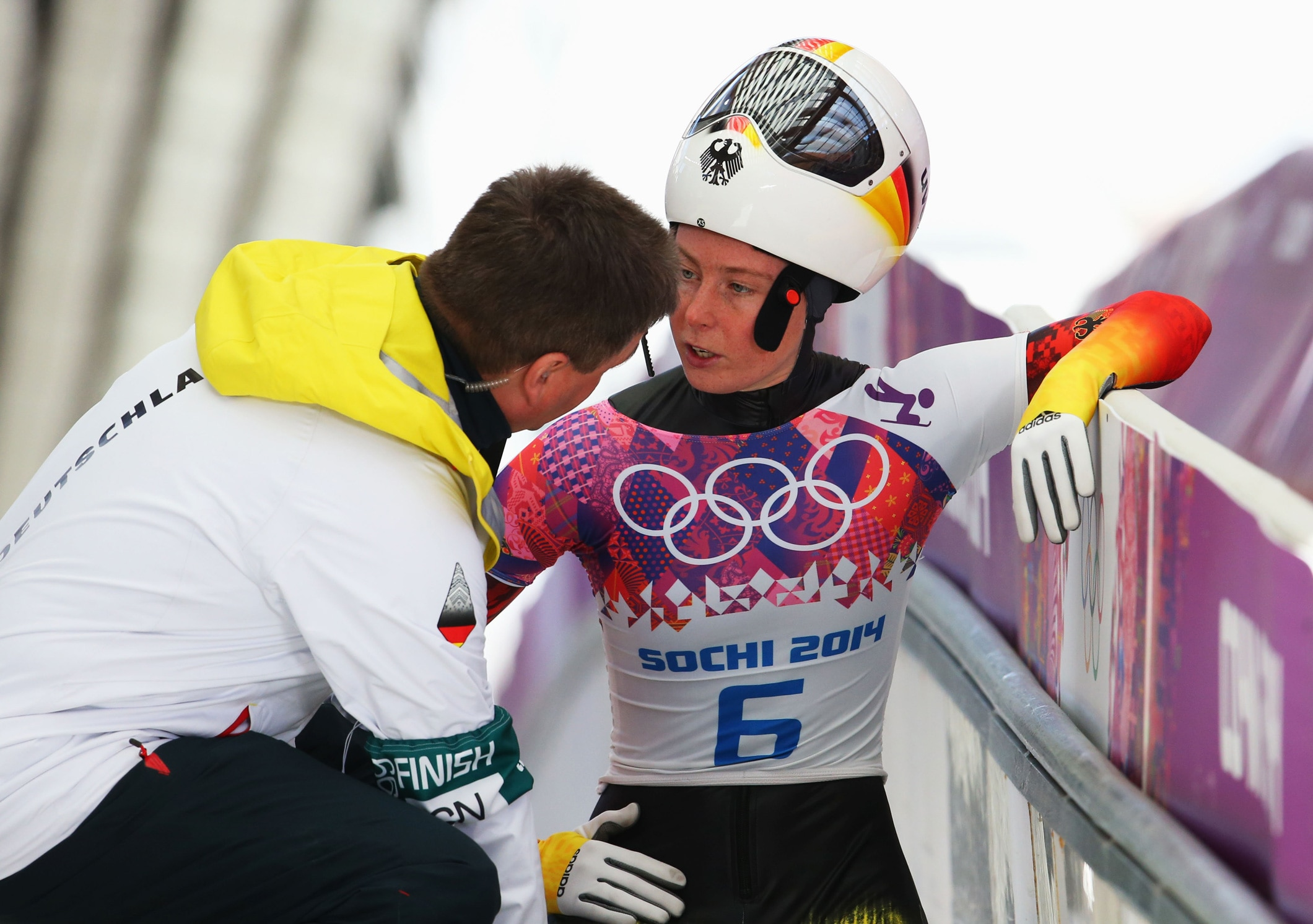 Marion Thees of Germany talks with her coach at Sochi 2014