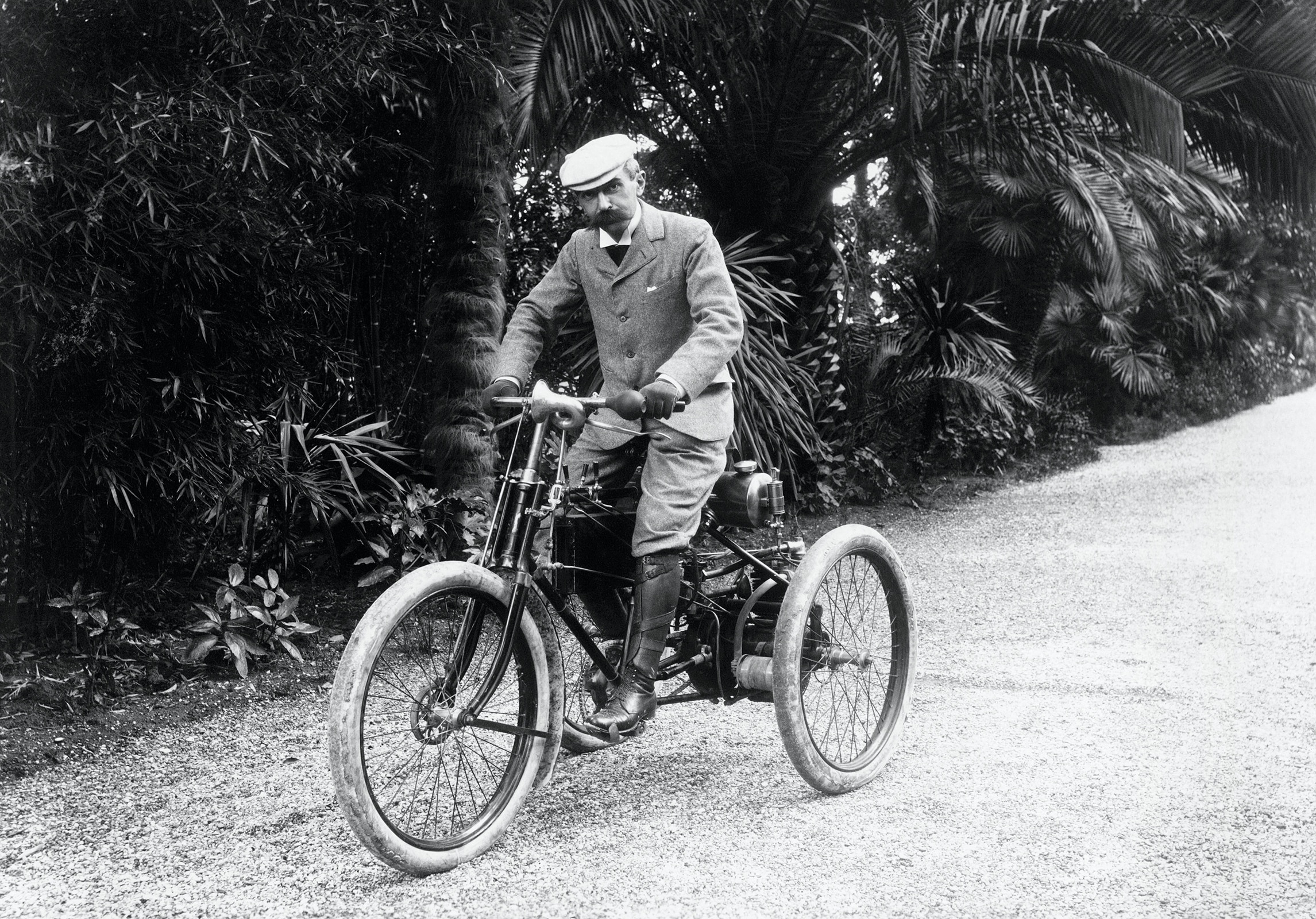 Baron Pierre de COUBERTIN on a motor tricycle in the south of France.