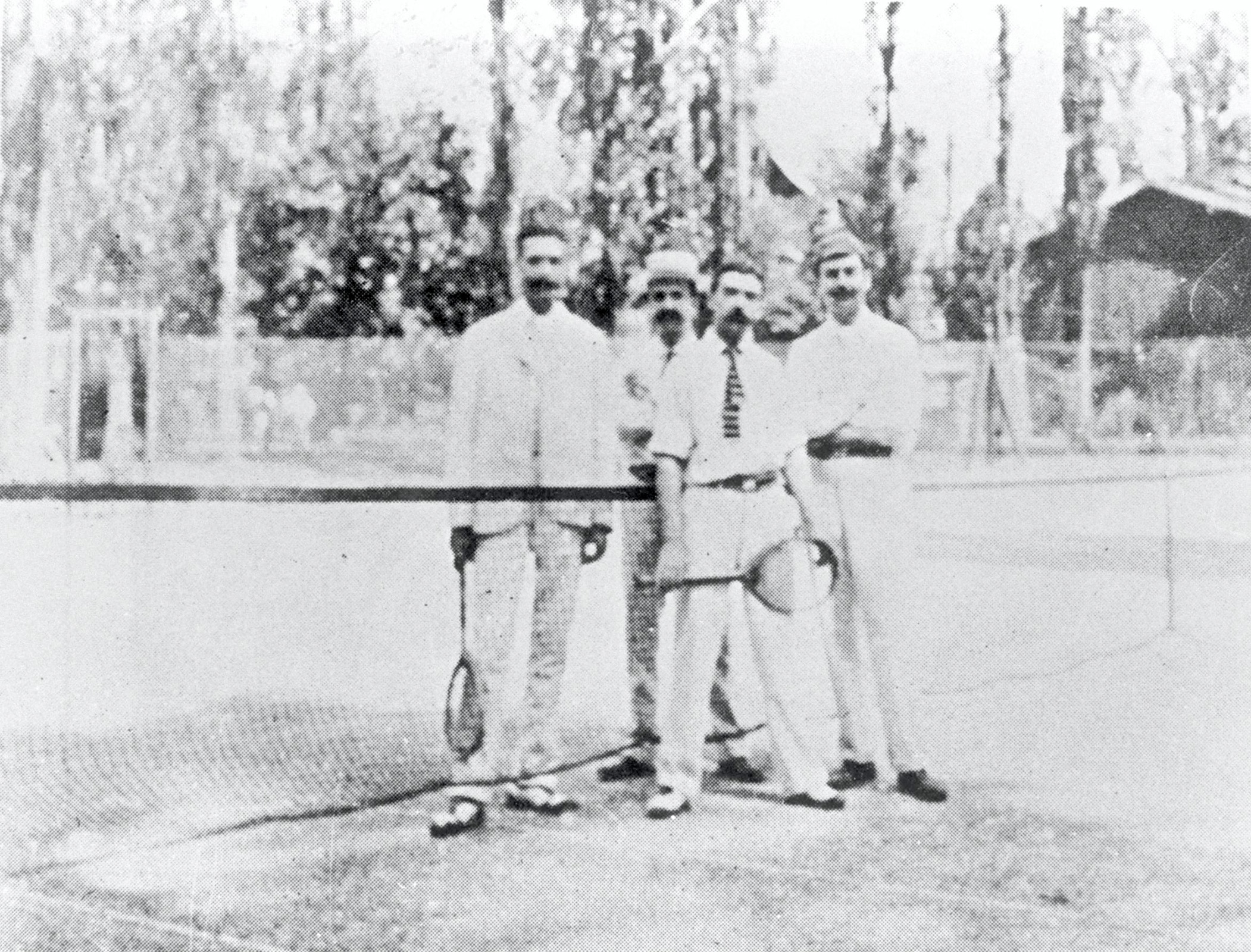 Baron Pierre de COUBERTIN on a tennis court.