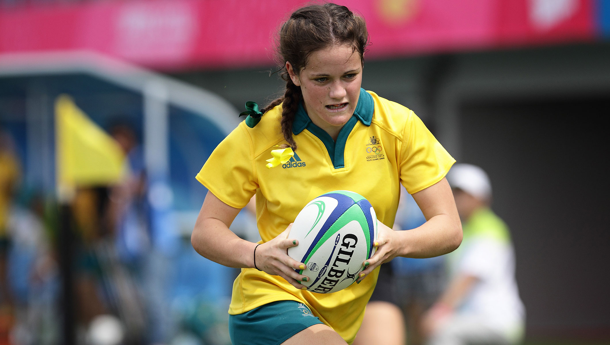 Dom du Toit of Australia runs with the ball and scores a try at the Rugby Sevens Final of the Nanjing 2014 Summer Youth Olympic Games
