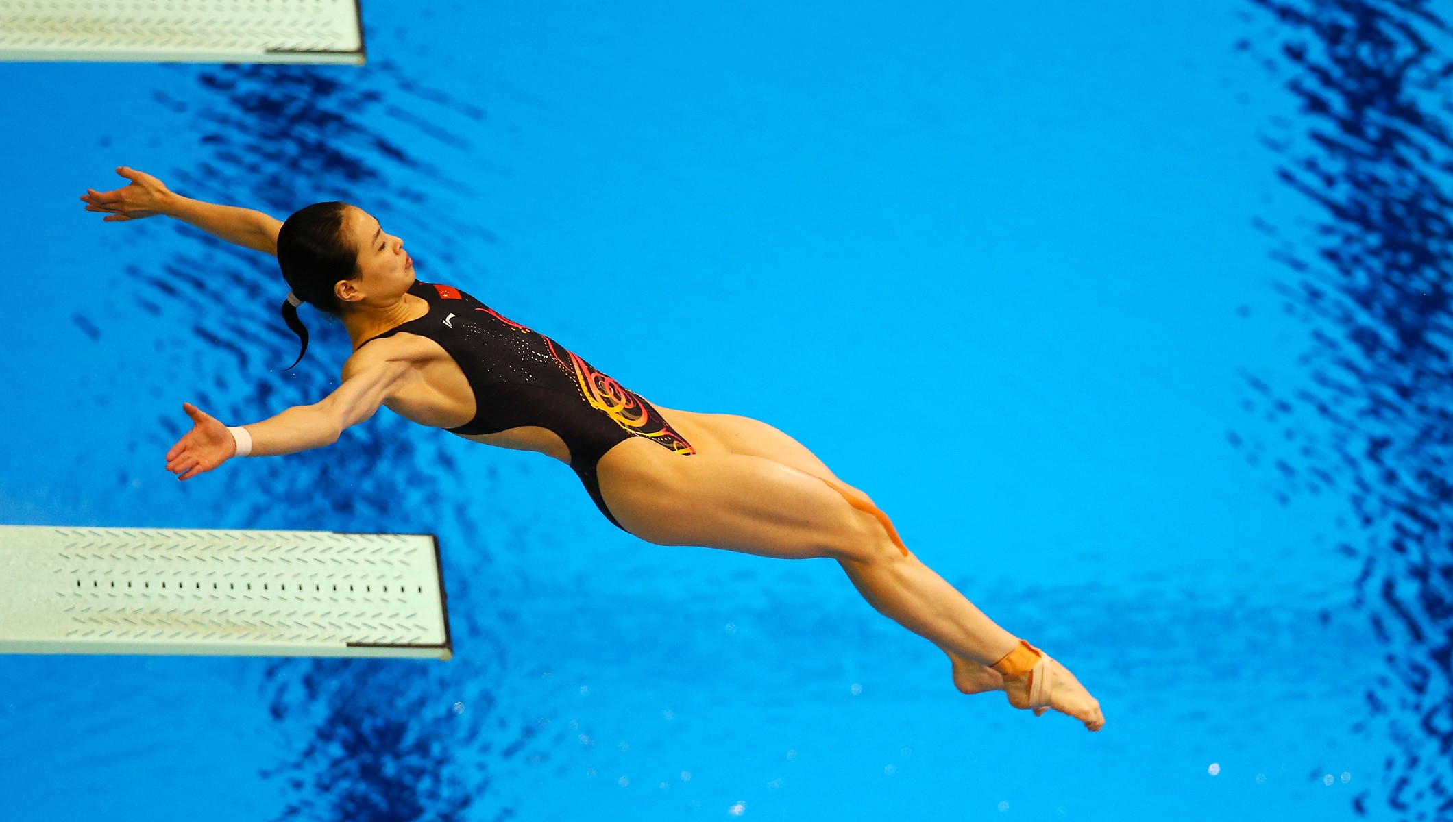 Wu Minxia performs a dive