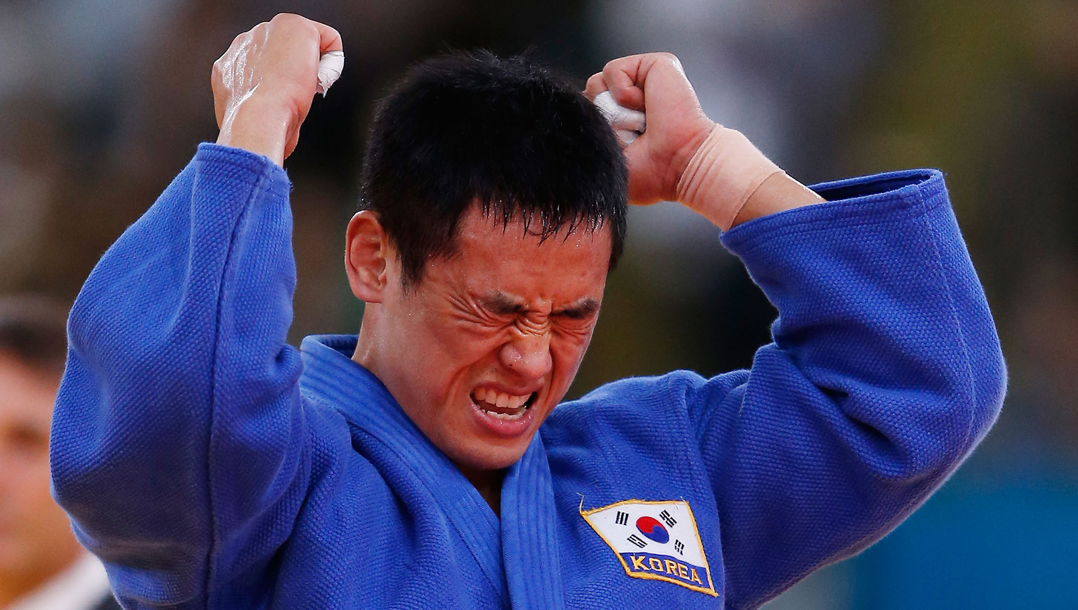 Dae-Nam Song of Korea celebrates winning the gold medal during the Men's -90 kg Judo on Day 5 of the London 2012 Olympic Games