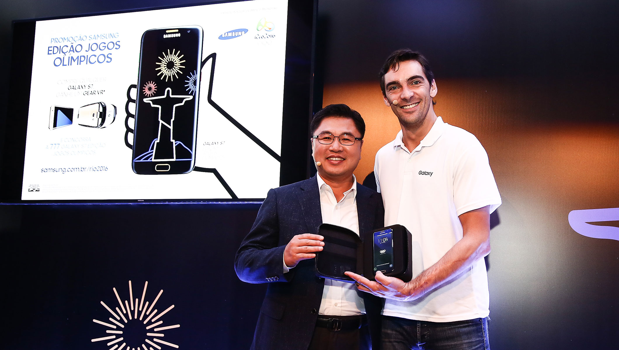 Vice President of the Mobile Division of Samsung Brazil, Changhoon Yoon, introducing Galaxy S7 edge Olympic Games Limited Edition with Athens Olympic gold medalist and former volleyball player, Giba, during a Samsung event in Sao Paulo, Brazil to highlight Samsung's Rio 2016 Olympic Games initiatives.