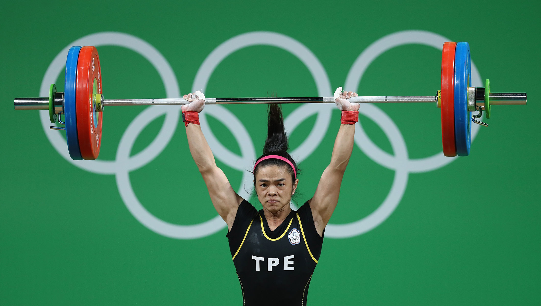 Shu-Ching Hsu of Chinese Taipei competes during the Women's 53kg Group A weightlifting contest on Day 2 of the Rio 2016 Olympic Games at Riocentro - Pavilion 2 on August 7, 2016 in Rio de Janeiro, Brazil.