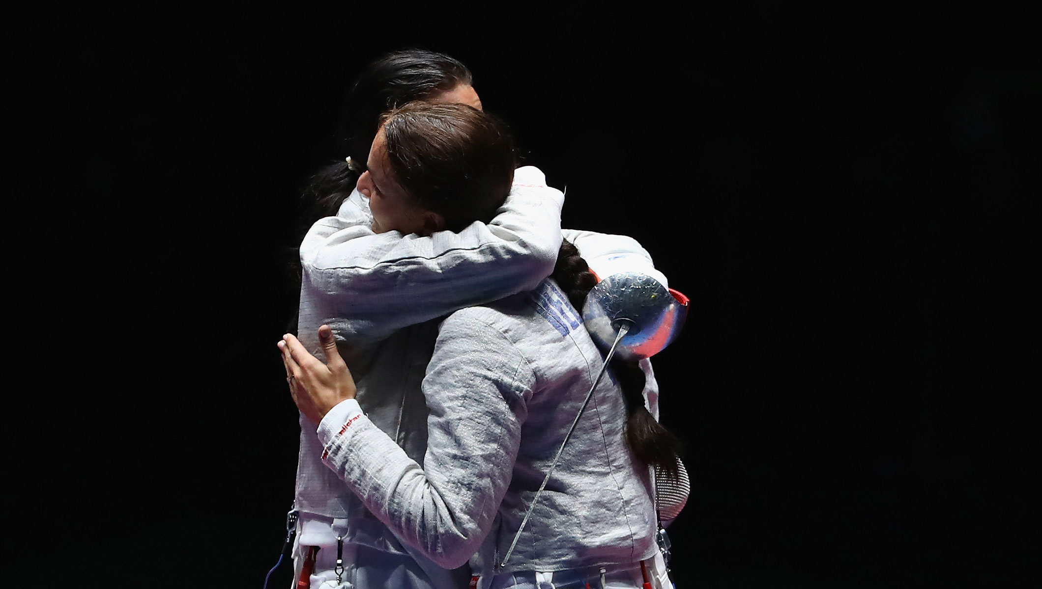 Sofya Velikaya of Russia (L) and Yana Egorian of Russia embrace following the Women's Individual Sabre Gold Medal Bout on Day 3 of the Rio 2016 Olympic Games at Carioca Arena 3 on August 8, 2016 in Rio de Janeiro, Brazil.