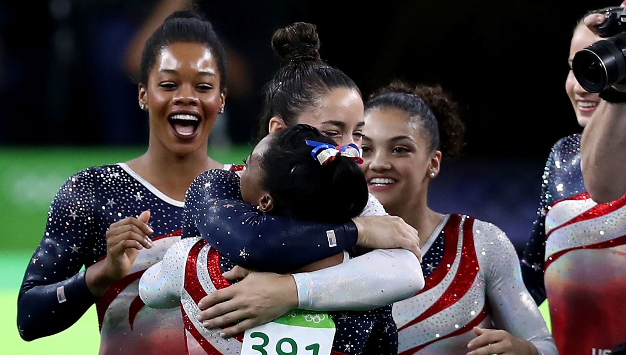 Simone Biles (front) of the United States is congratulated by her team mates after competing on the floor during the Artistic Gymnastics Women's Team Final on Day 4 of the Rio 2016 Olympic Games at the Rio Olympic Arena on August 9, 2016 in Rio de Janeiro, Brazil.