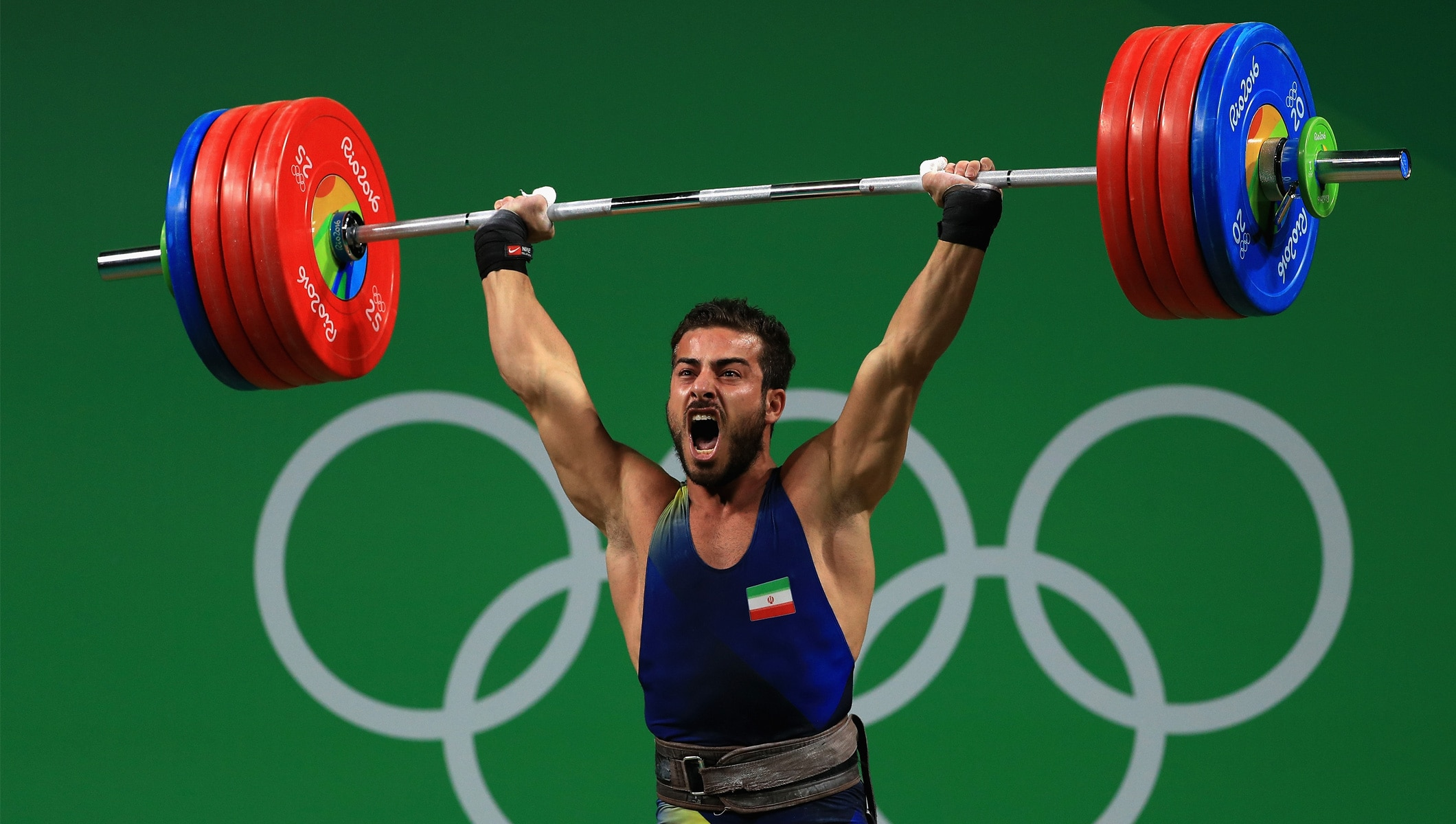 rostami breaks world record in 85kg weightlifting olympic news