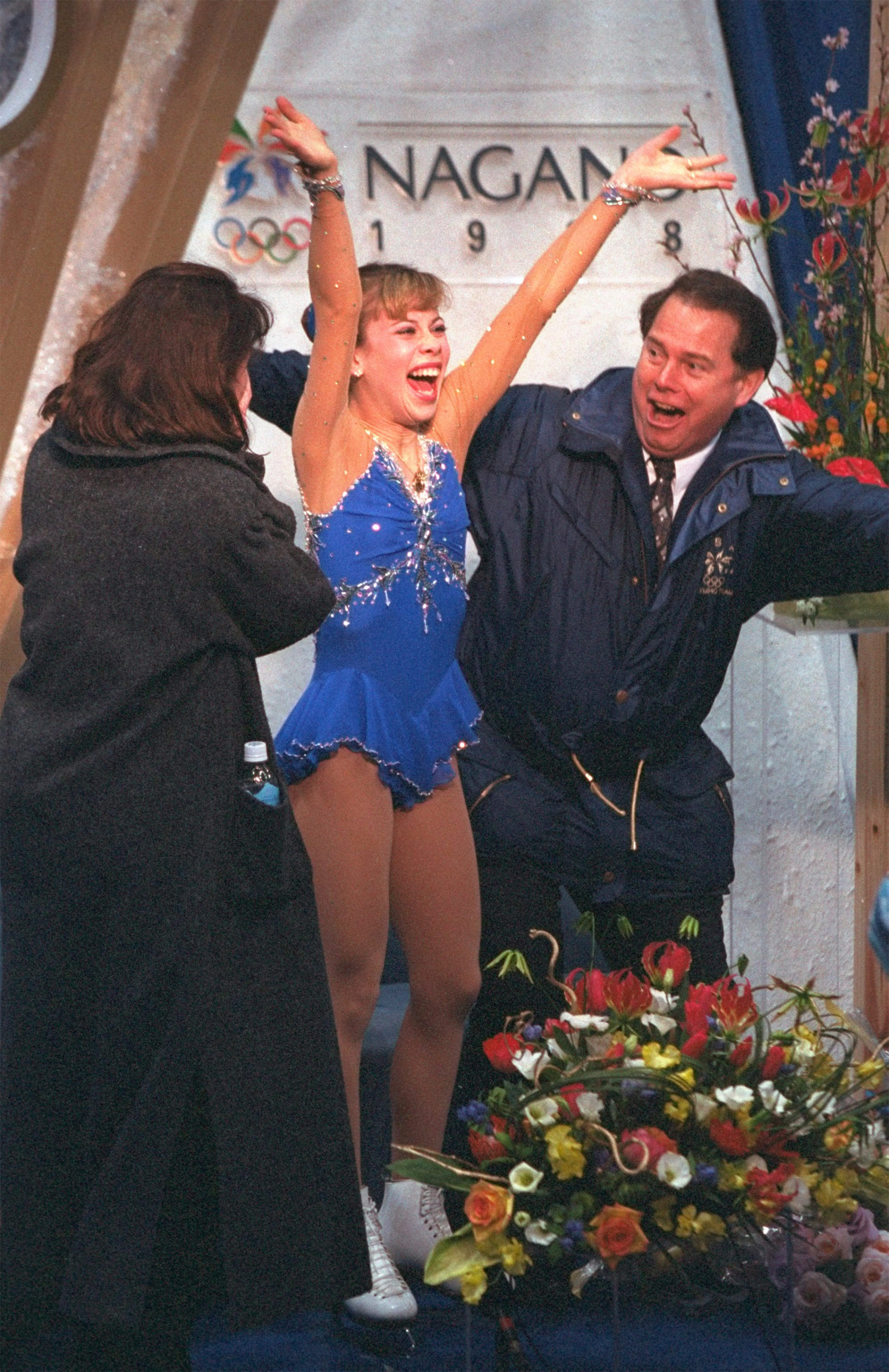 Tara Lipinski of the USA reacts as her scores flash on the screen during the free skate competition at White Ring Arena during the 1998 Winter Olympic Games in Nagano, Japan. Lipinski won the gold medal in the event.