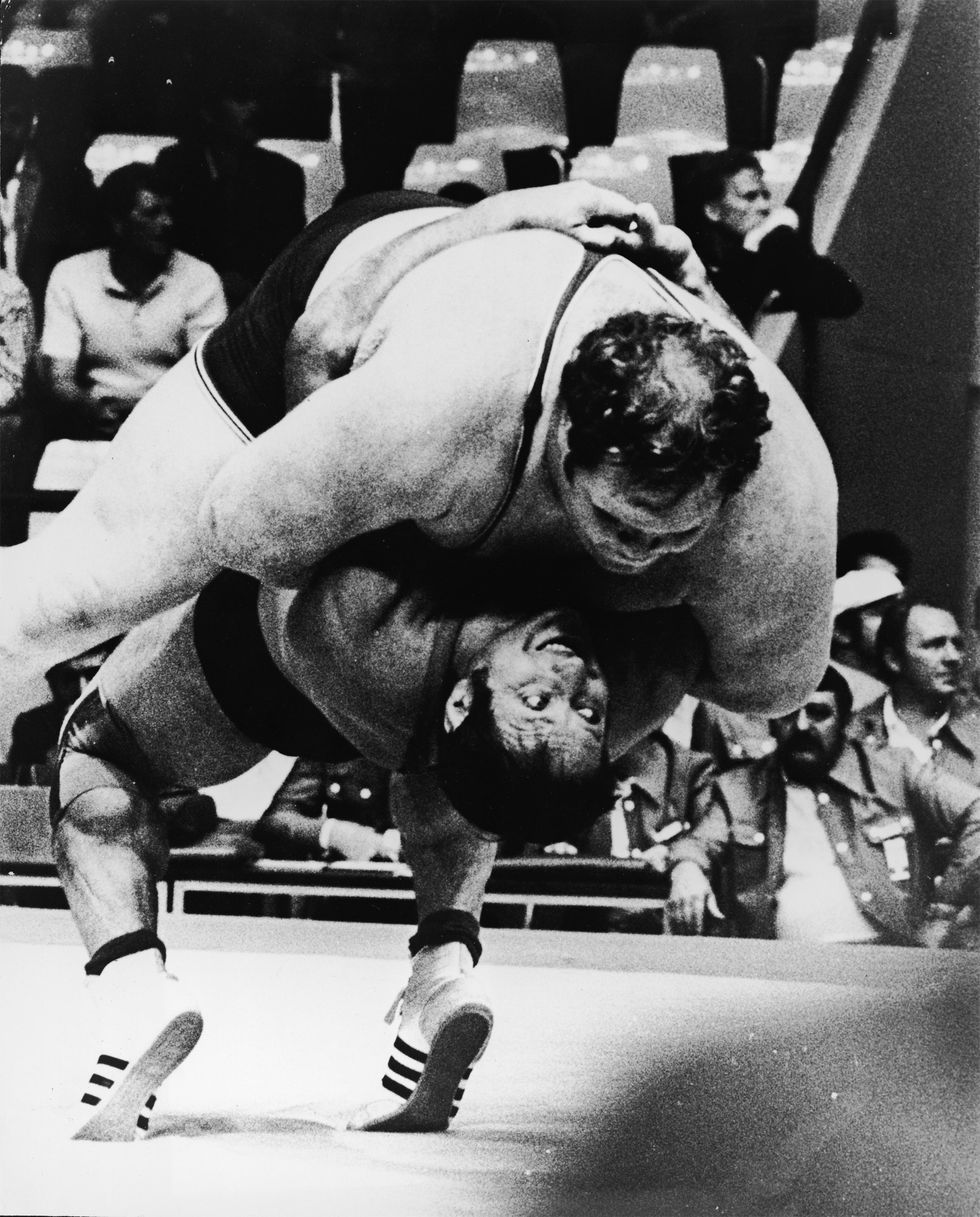 German heavyweight wrestler Wilfried Dietrich throws 400 pound American opponent Chris Taylor on October 31, at the 1972 Munich Olympic Games. This photograph won recognition from a panel of international photographers as the best taken at the Munich games.