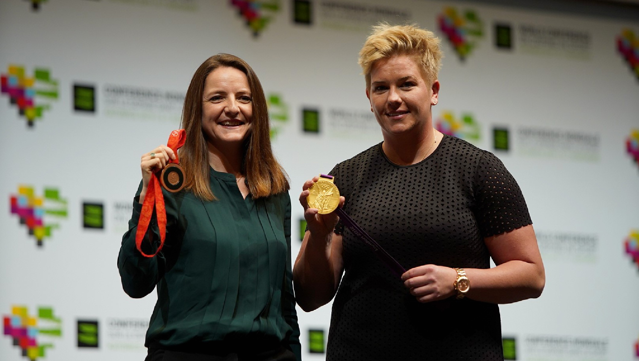 Goldie Sayers and Anita Wlodarczyk holding their medals